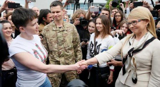 Ukrainian servicewoman Nadiya Savchenko shakes hands with Ukrainian former Prime Minister and leader of Batkivshchyna (Fatherland) party Yulia Tymoshenko at Boryspil International airport outside Kiev, Ukraine, May 25, 2016. REUTERS/Gleb Garanich