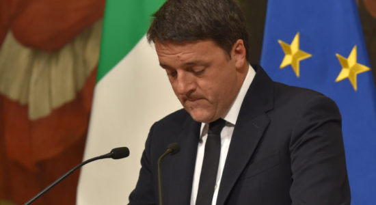 """Italy's Prime Minister Matteo Renzi announces his resignation during a press conference at the Palazzo Chigi after the results of the vote for a referendum on constitutional reforms, on December 4, 2016 in Rome. """"My experience of government finishes here,"""" Renzi told a press conference after the No campaign won what he described as an """"extraordinarily clear"""" victory in the referendum on which he had staked his future.  / AFP / Andreas SOLARO        (Photo credit should read ANDREAS SOLARO/AFP/Getty Images)"""